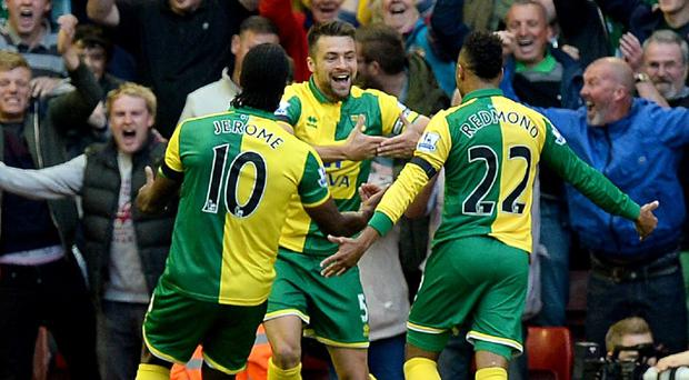 It was certainly a day to remember for Norwich captain Russell Martin, pictured centre