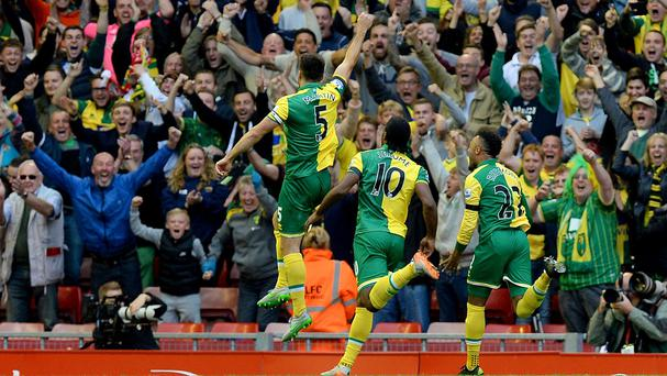 Captain Russell Martin, left, celebrates scoring Norwich's goal hours after the birth of his son