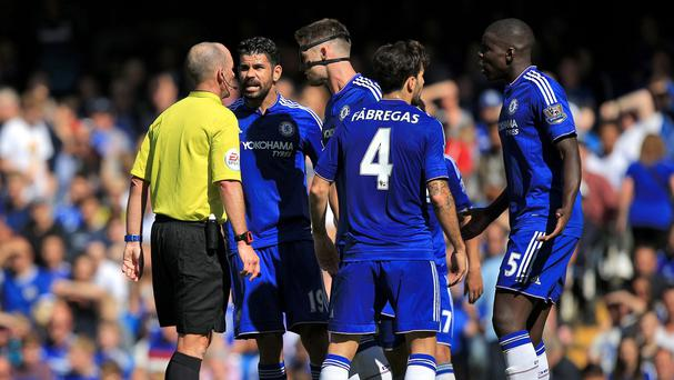 Diego Costa, pictured second left, has been cited for an incident involving Arsenal defender Laurent Koscielny