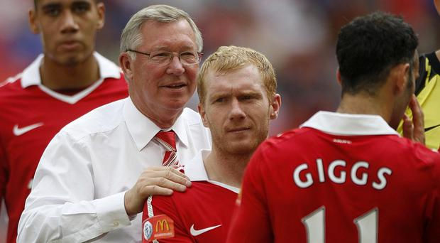 Sir Alex Ferguson, left, promoted academy players such as Paul Scholes, centre and Ryan Giggs