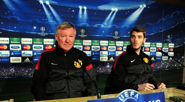Sir Alex Ferguson, left, is happy to see David de Gea, right, helping Manchester United again