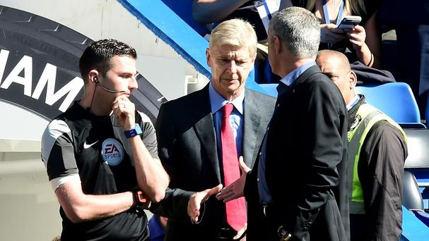Chelsea manager Jose Mourinho, right, and Arsenal manager Arsene Wenger, centre, appear to still be feuding