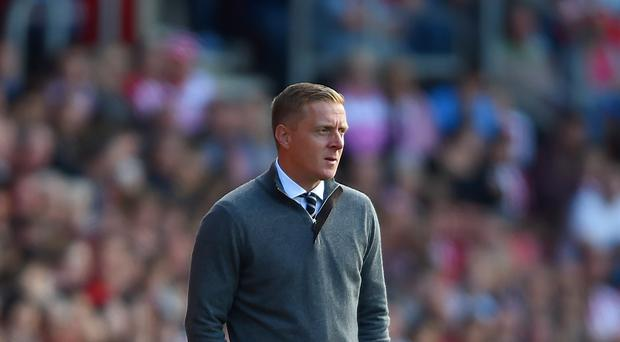 Garry Monk, pictured, is a big fan of Tottenham boss Mauricio Pochettino