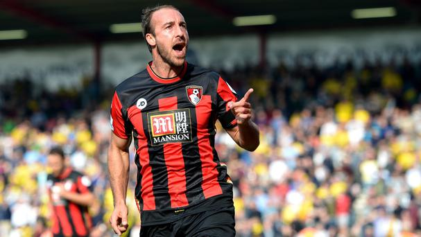 Glenn Murray opened his goalscoring account but also missed a penalty as Bournemouth drew