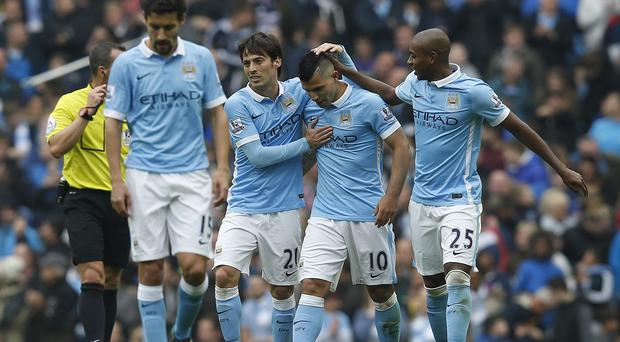 Sergio Aguero, centre right, was back in form with a bang for Manchester City