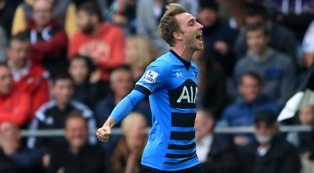 Tottenham's Christian Eriksen celebrates his second equaliser in their 2-2 draw at Swansea