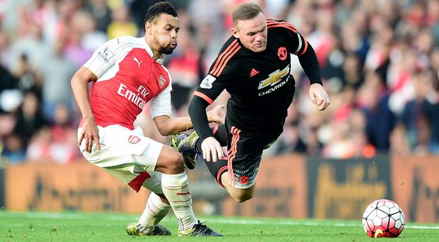 Francis Coquelin, left, played his part in a fine Arsenal display
