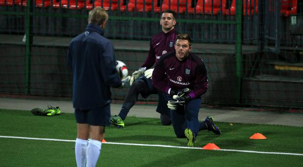 Jack Butland, right, will make his first England start on Monday night