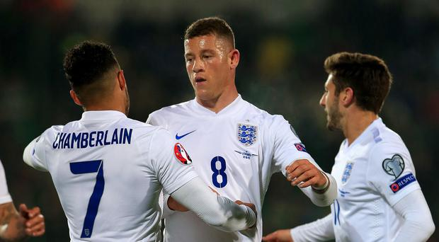 Ross Barkley (centre) celebrates scoring England's first goal against Lithuania