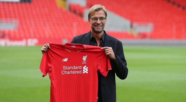 Liverpool's new manager Jurgen Klopp gets down to business on Saturday