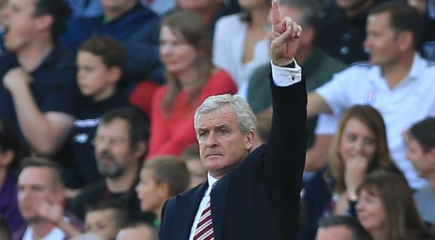 Mark Hughes, pictured, takes his Stoke side to Wales to face Garry Monk's Swansea on Monday
