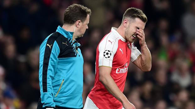 Arsenal's Aaron Ramsey, right, reacts after going off injured against Bayern Munich