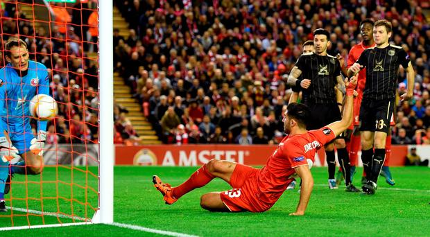 Emre Can slides in to level the score for Liverpool