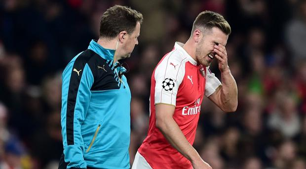 Aaron Ramsey, right, suffered a hamstring injury against Bayern Munich and is set for around a month on the sidelines
