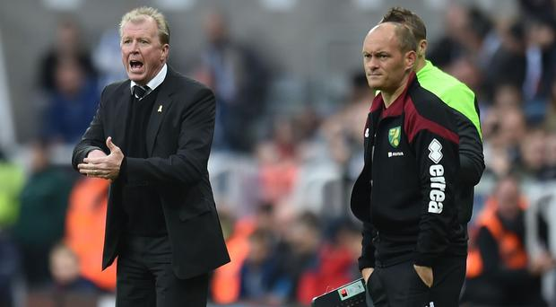 Norwich manager Alex Neil, right, was less than impressed by his side's 6-2 defeat at Newcastle