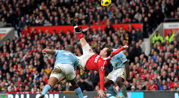 Wayne Rooney scored his most famous goal against derby rivals Manchester City four years ago