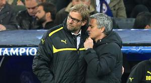 Liverpool manager Jurgen Klopp, pictured left, with Jose Mourinho