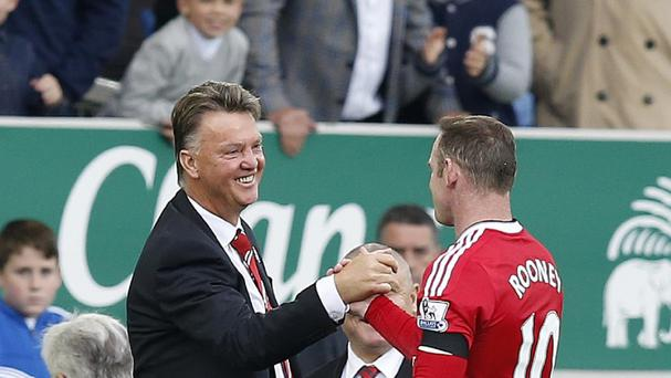 Louis van Gaal, pictured left, feels Wayne Rooney, pictured right, may be too eager to score goals