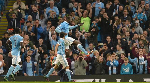 Yaya Toure, top, fired home a winning penalty for Manchester City