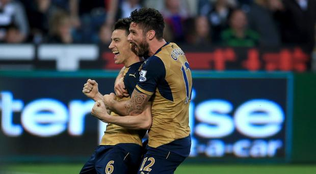 Laurent Koscielny, left, scored Arsenal's second goal at Swansea
