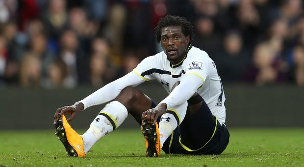 Quique Sanchez Flores has refused to rule out a move for Emmanuel Adebayor, pictured