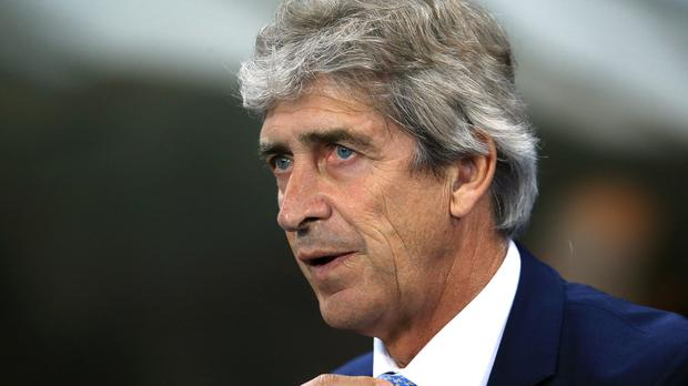 Manchester City manager Manuel Pellegrini, pictured, has welcomed Remi Garde to the Premier League