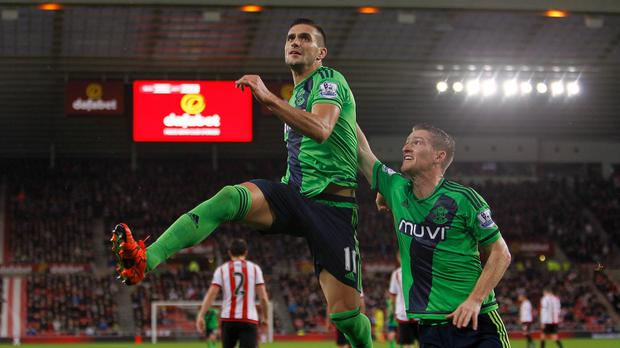 Southampton's Dusan Tadic, left, celebrates his successful spot kick against Sunderland