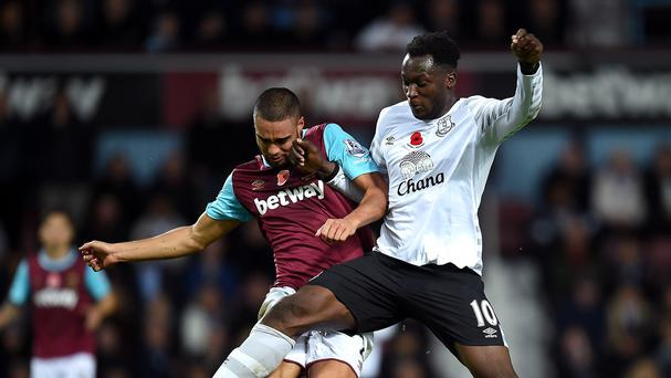 Everton goalscorer Romelu Lukaku, right, battles for possession with West Ham's Winston Reid