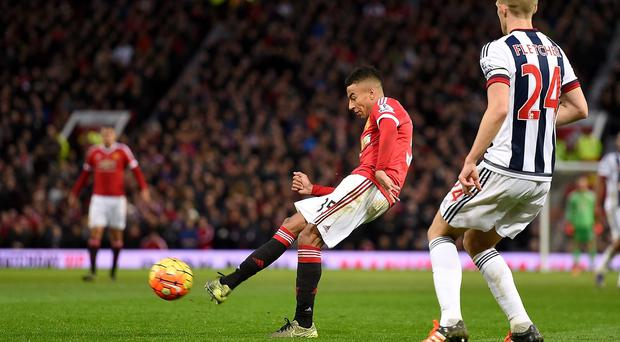 Jesse Lingard, left, curls in the opening goal for Manchester United against West Brom
