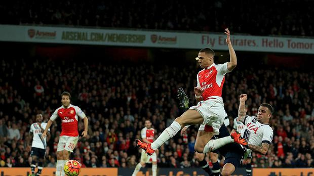 Kieran Gibbs, centre, netted a late equaliser for Arsenal in the north London derby against Tottenham