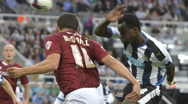 Newcastle's Cheick Tiote, right, is back in business