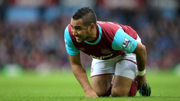 Dimitri Payet faces three months out with an ankle injury