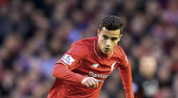 Liverpool's Philippe Coutinho insists the players are working hard to get things right in training