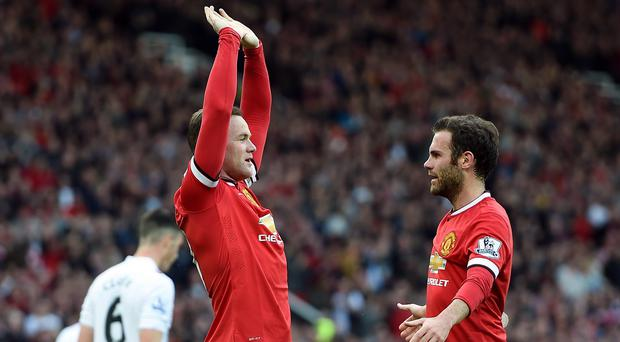 Juan Mata has defended Manchester United team-mate Wayne Rooney