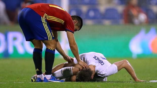 Michael Carrick went down injured in the 2-0 loss to Spain