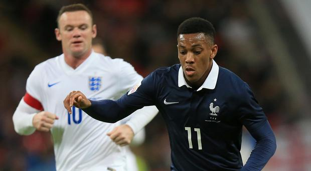 Anthony Martial, pictured right, suffered an injury against England