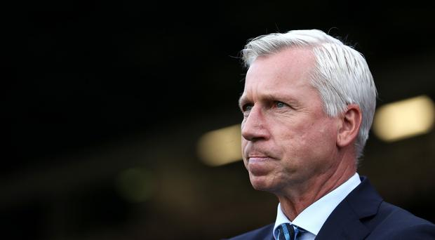 Alan Pardew has spoken to his French players after the tragic events in Paris