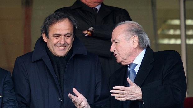 Michel Platini and outgoing FIFA president Sepp Blatter