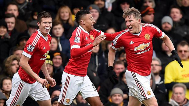 Bastian Schweinsteiger, right, celebrates with team-mates after a late own goal helped United secure a 2-1 win over Watford