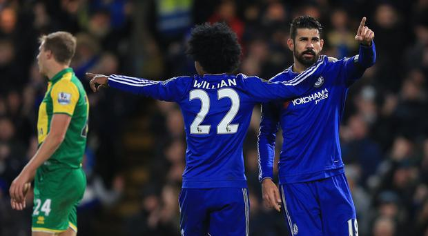 Diego Costa, right, celebrates his goal against Norwich