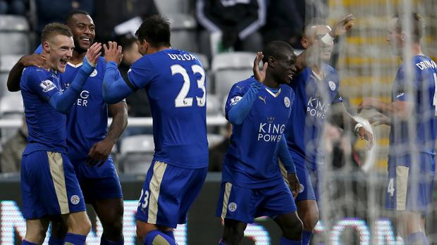 Jamie Vardy, left, celebrates with his team-mates after scoring for the 10th game in a row