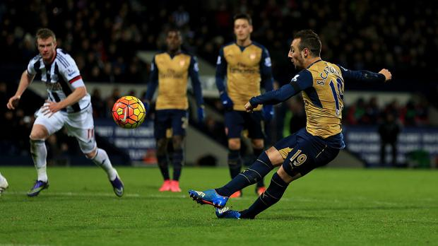 Arsenal's Santi Cazorla slips to miss a late penalty as the Gunners lost 2-1 at West Brom