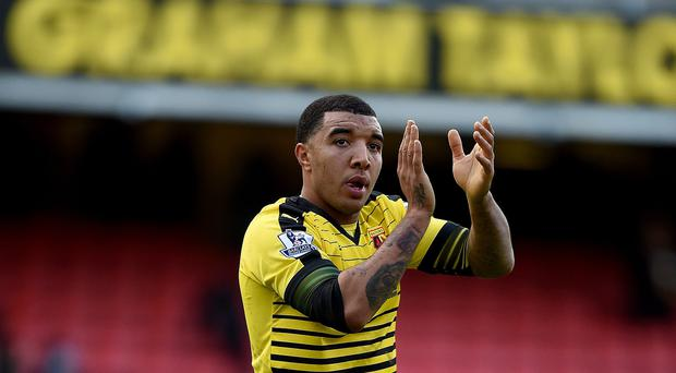 Troy Deeney's injury-time own goal gifted Manchester United a 2-1 win at Watford on Saturday.