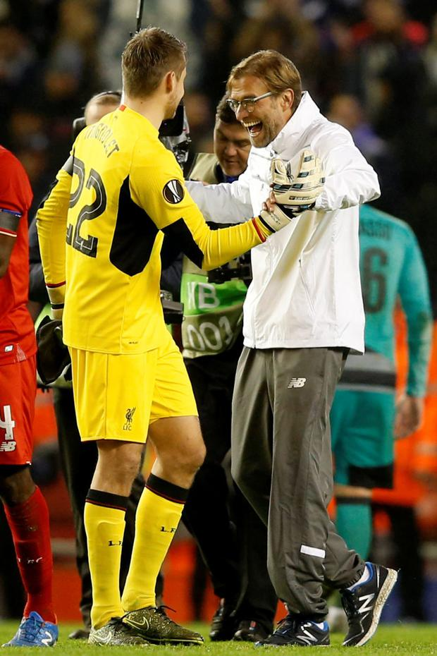 Liverpool boss Jurgen Klopp celebrates with Simon Mignolet after the final whistle at Anfield last night
