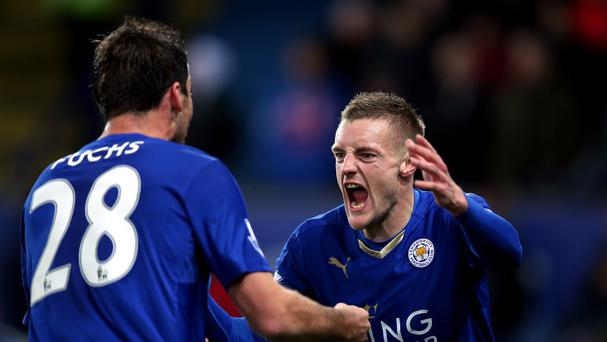 Leicester's Jamie Vardy celebrates his record-breaking goal with Christian Fuchs in the 1-1 draw with Manchester United.