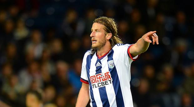 West Brom's Jonas Olsson is hoping to keep his place against West Ham on Sunday