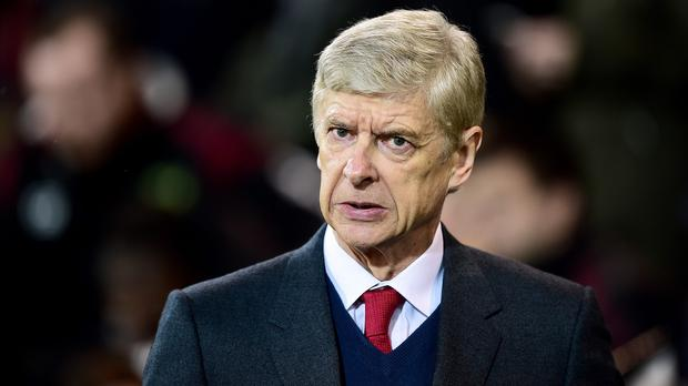 Arsene Wenger, pictured, fears Alexis Sanchez is playing down a hamstring injury that he suffered in Arsenal's draw at Norwich