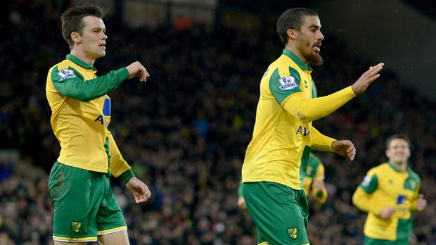 Lewis Grabban, pictured right, scored on his return to the Norwich side on Sunday