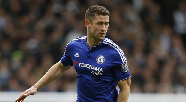 Gary Cahill has extended his stay at Chelsea by four years