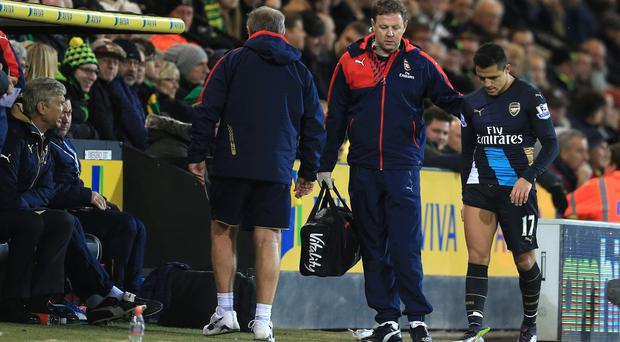 Arsenal boss Arsene Wenger does not know how long Alexis Sanchez, right, will be out for